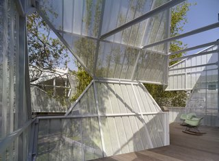 A Perforated Screen Brings Privacy and Natural Light to This Bold Venice Home - Photo 8 of 9 -