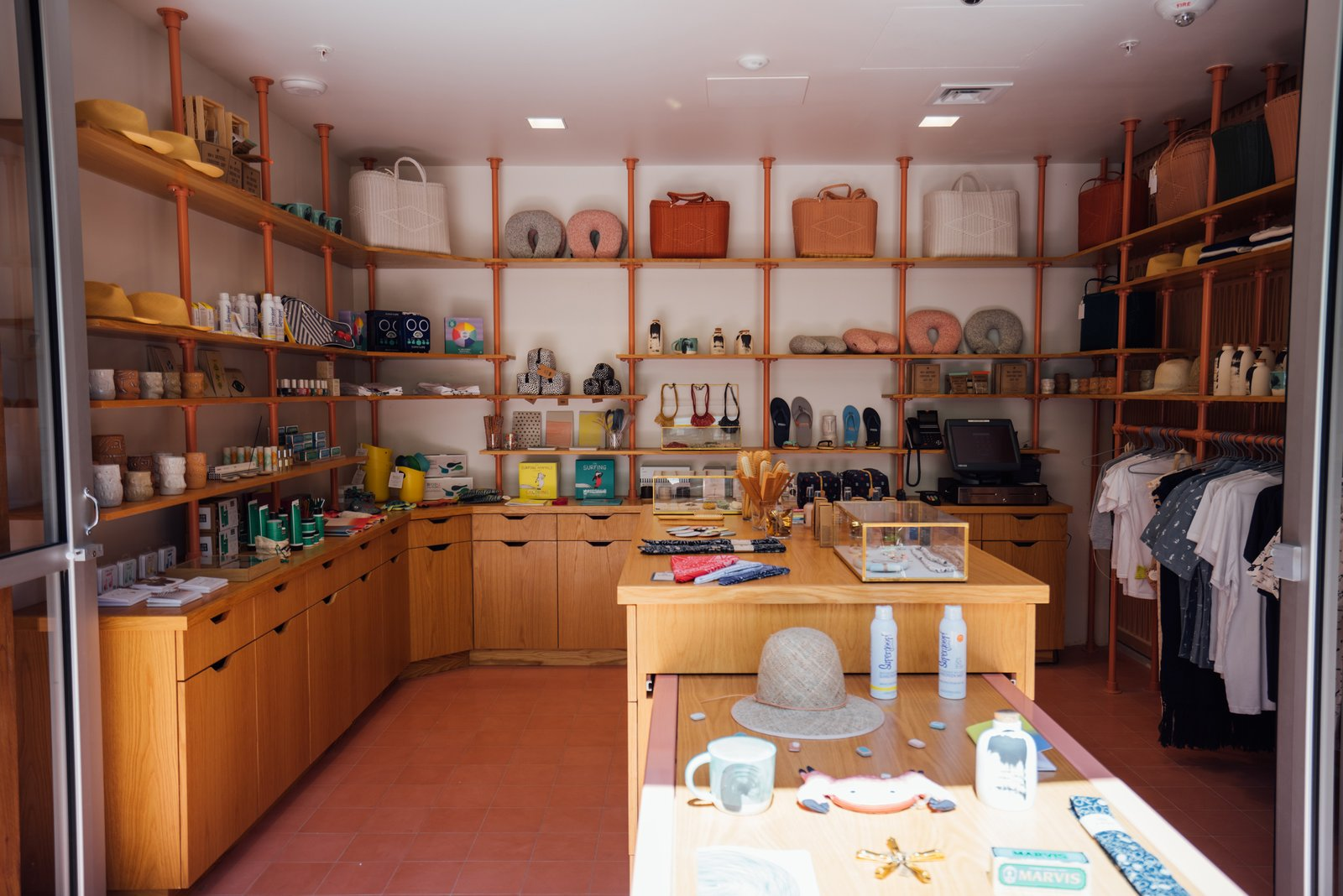 The store sells a mix of goods, some of which have been made custom for the hotel including hats by Kiriko, beach towels and hats with the hotel's wallpaper pattern, and the ukuleles that are in each guest room. Tagged: Storage Room and Shelves Storage Type.  Photo 18 of 18 in Waikiki's Midcentury Revival Continues to Flourish With a New Jet Set-Inspired Hotel