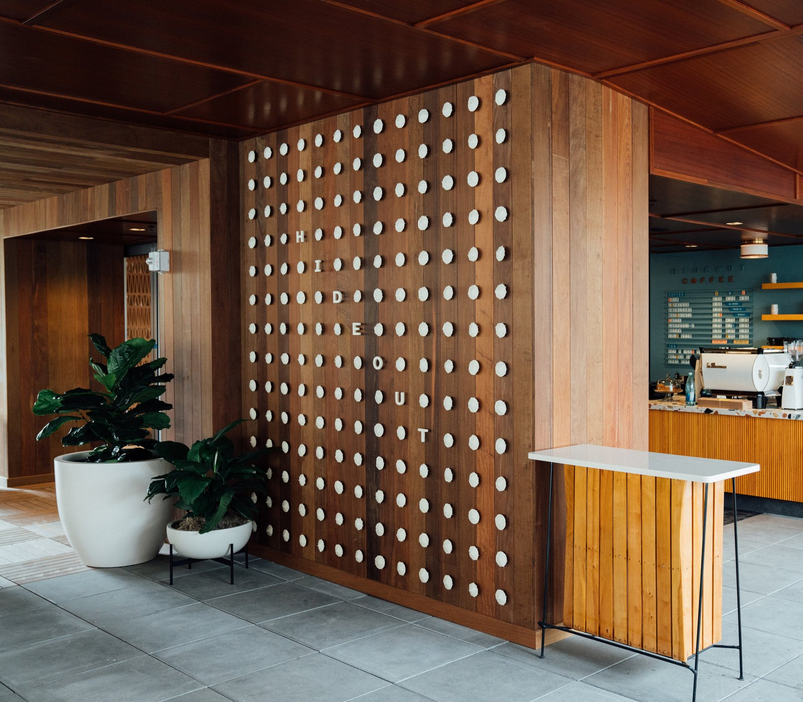 Hallway and Concrete Floor Another custom installation by the OMFGCO Art Department includes a Hideout sign made with modified cocktail umbrellas.  Photo 13 of 18 in Waikiki's Midcentury Revival Continues to Flourish With a New Jet Set-Inspired Hotel