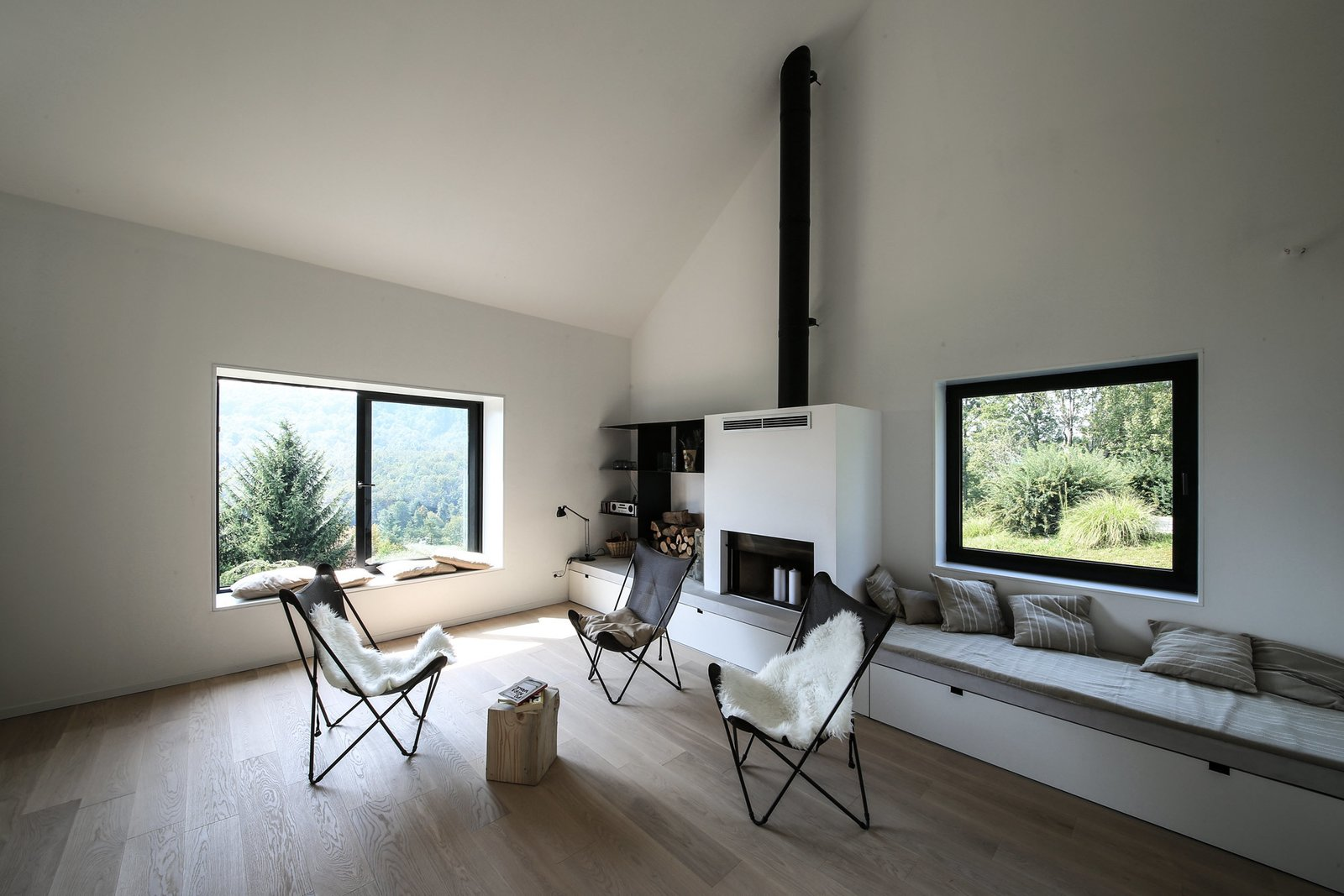 Living Room, Medium Hardwood Floor, Chair, Standard Layout Fireplace, and Bench  Photo 8 of 12 in Gorski Kotar House