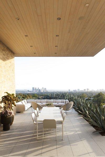 Large Patio, Porch, Deck, Stone Patio, Porch, Deck, Concrete Patio, Porch, Deck, Chair, Exterior, and House Building Type  Summitridge by Marmol Radziner
