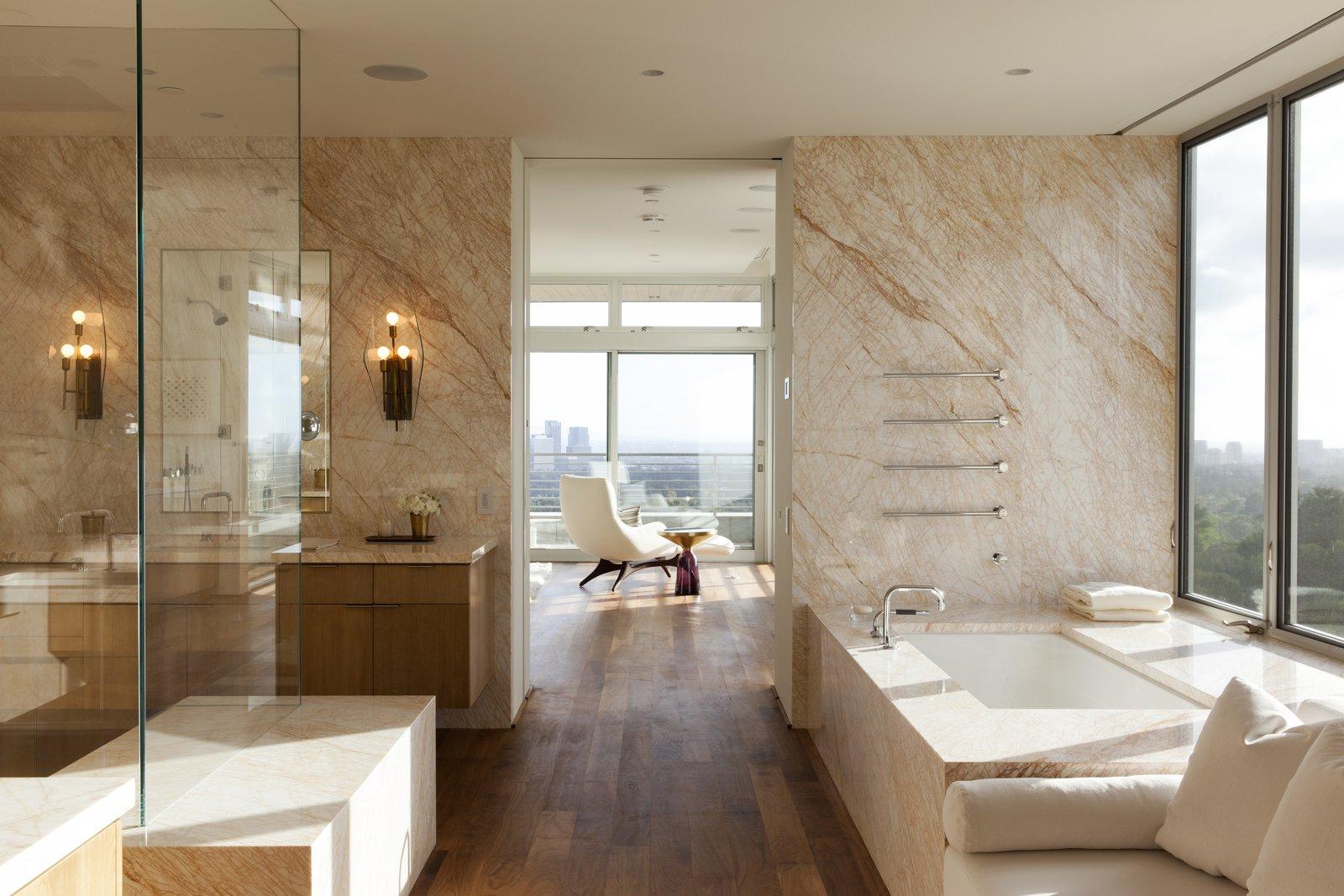 Bath Room, Drop In Tub, Marble Wall, Accent Lighting, Drop In Sink, Medium Hardwood Floor, and Marble Counter  Summitridge by Marmol Radziner