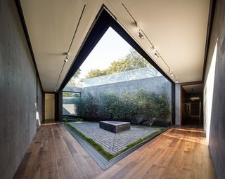 One of the last elements included was the interior courtyard, which was conceived as a solution to bring more light and nature to the private, underground program. The enclosed nature of this space provides a beautiful contrast to the open and expansive views above ground.