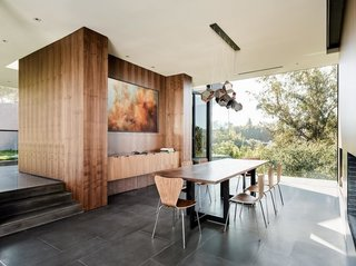Custom walnut panels by GL Veneer have been incorporated in the dining room.