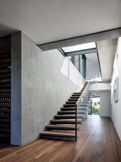 A staircase leads up from the bedroom on the lower level to the living areas on the upper floor.