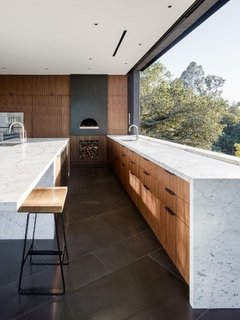 The kitchen features a pizza oven by Mugnaini.
