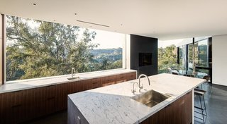 In the kitchen, a large window presents unobstructed canyon views.
