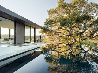 """A smaller section of the house was placed alongside the pool as a pavilion. """"It was important on this site to make it feel like nature was coming first, and the house second,"""" says the firm's founder, Noah Walker, who thinks of design as a spiraling process. """"In this case, the initial concept was strong, so the design was more a case of a series of progressive refinements."""""""