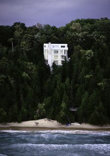 Richard Meier's 1973 Douglas House Receives Historic Designation - Photo 1 of 4 - Nestled into a steeply sloped waterfront site on Lake Michigan, the all-white, starkly modernist home is defined by verticality.