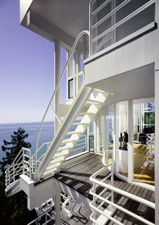 Richard Meier's 1973 Douglas House Receives Historic Designation - Photo 2 of 4 - A series of ladders and cantilevered staircases connect each level of home from the exterior, offering a dramatic cascading promenade with an expansive view of Lake Michigan.