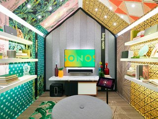 Each listening station features different simulated home environments—a kitchen and living room, for example—paired with unique interior elements. This one features custom wall coverings by artist Mark Chamberlain.