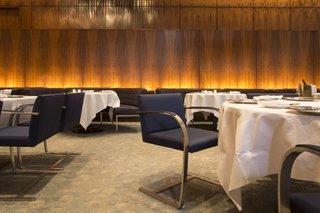 The Grill Room featured cantilevered Brno chairs by Ludwig Mies van der Rohe and banquettes by Philip Johnson, who was known to dine at his preferred seat, at table 32.