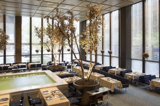 Featuring a bubbling water feature punctuated with seasonal trees, the International Style–designed Pool Room was home to many a power lunch over the years.