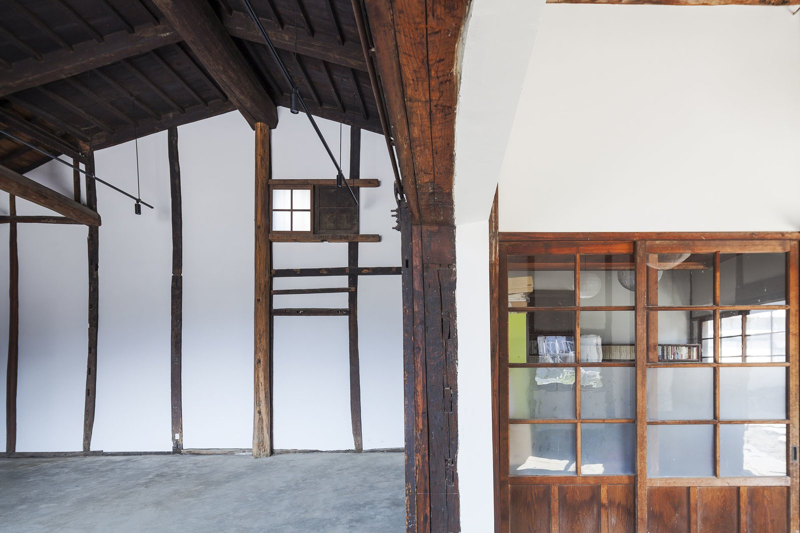 New wooden wainscoting, found in many traditional kura warehouses, was added to the interior.  Photo 4 of 8 in Saved From Demolition, a Japanese Sake Warehouse Sees a Second Life