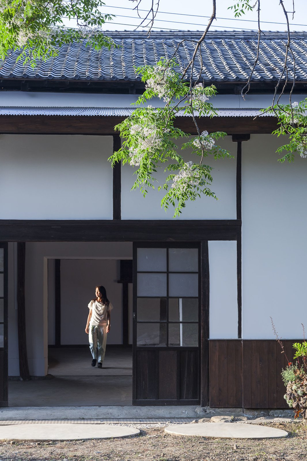 Rather than tear it down and build anew, the team repaired walls, rebuilt doors, and worked to preserve elements of the building's traditional design.  Photo 7 of 8 in Saved From Demolition, a Japanese Sake Warehouse Sees a Second Life