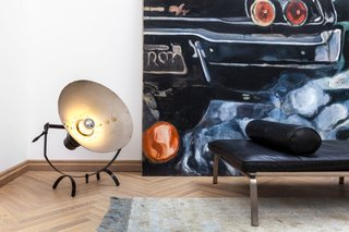 Vintage details, like this metal floor lamp, contrast with parquet floors in a subtle nod to an industrial aesthetic.