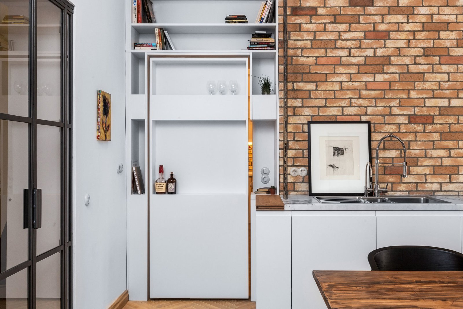 Kitchen, Wood Counter, and Marble Counter A view of the pivoting shelf door from the kitchen and dining area.  Photo 6 of 7 in A Hidden Passageway Makes Each Room in This Berlin Flat a Private Destination