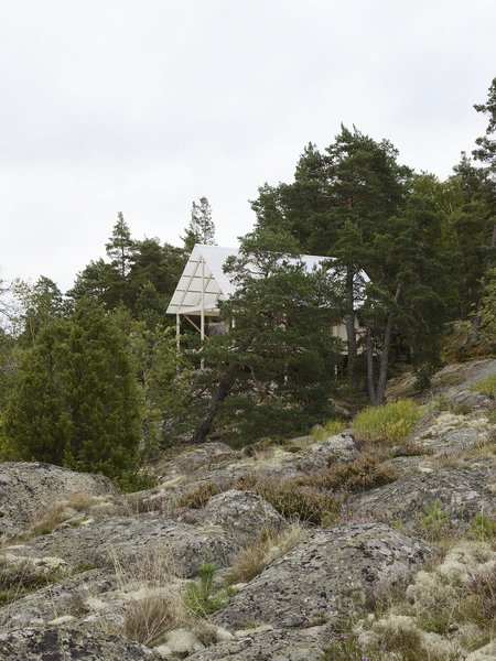 A Swedish Summer Cabin That Sits  Above and Among the Trees