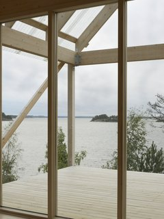 The roof portion made of corrugated fiber-reinforced plastic hangs above deck, which measures roughly 215 square feet and overlooks views of the water.