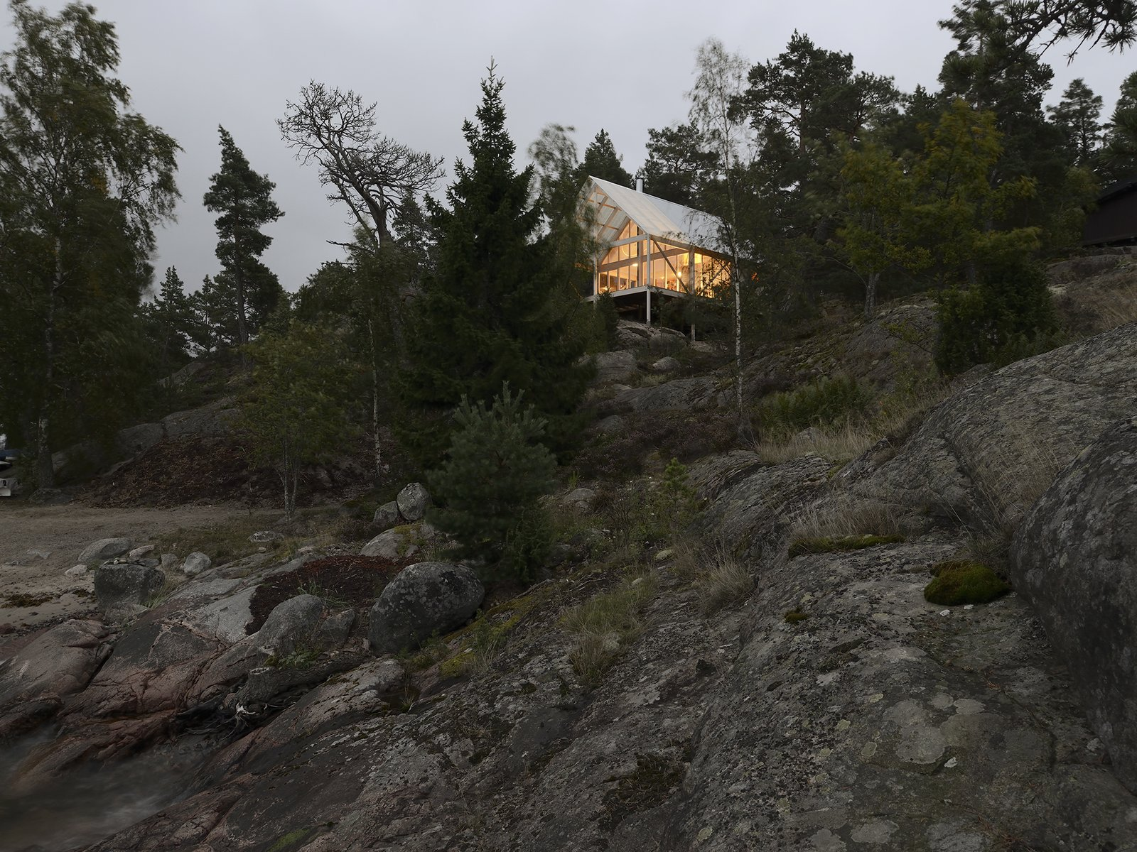 Exterior, Wood Siding Material, and House Building Type Though a clear celebration of Sweden's intense but fleeting summer seasons, the cabin is used year-round, and was constructed in eight months.  Photo 6 of 7 in A Swedish Summer Cabin That Sits  Above and Among the Trees