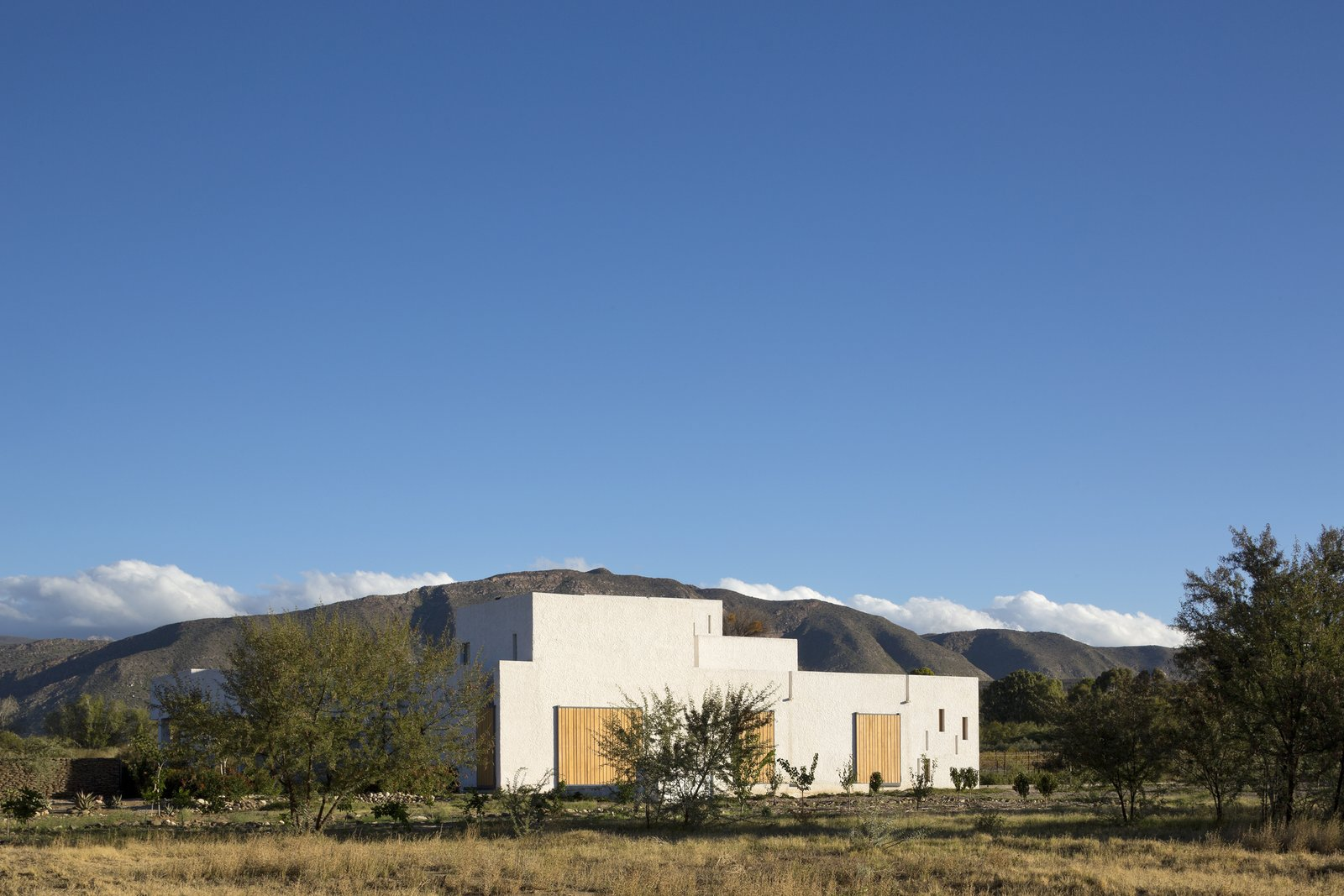 London-based firm Openstudio Architects designed a retreat on the outskirts of Prince Albert, a town that sits near a pass of the Swartberg mountain range in South Africa.  Photo 2 of 7 in A Minimalist Retreat at the Edge of South Africa's Karoo Desert
