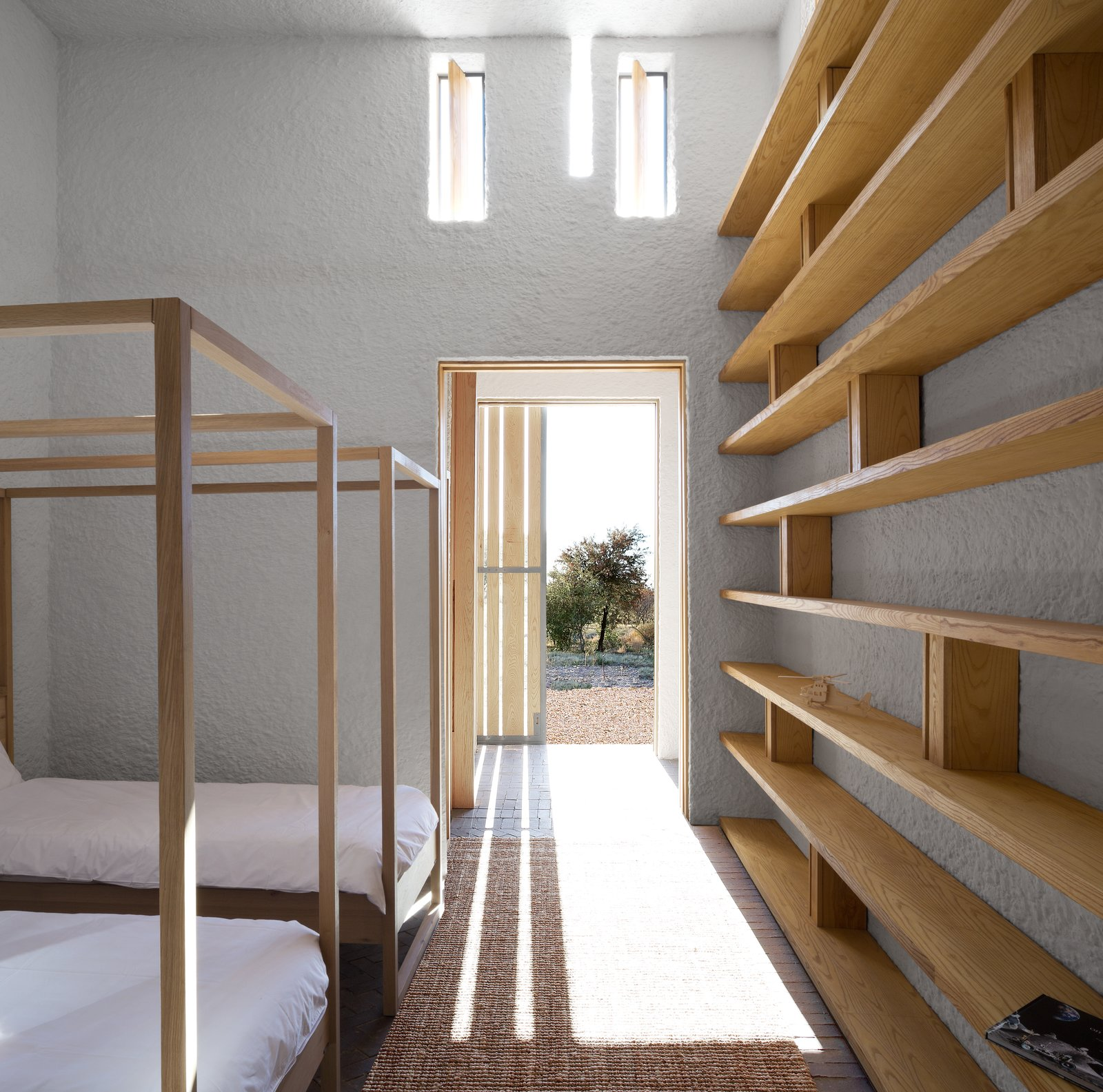 Openstudio worked with local builders, using a palette of regional materials: patterned brick, white ceramic tiles, and roughcast lime-washed plaster. Tagged: Bedroom and Bunks.  Photo 4 of 7 in A Minimalist Retreat at the Edge of South Africa's Karoo Desert