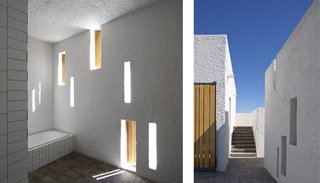 A series of narrow, vertical window openings punctuate the thick-walled facade of the structure, which is optimized for passive solar gains (left). A consistent application of surface materials throughout the interior and courtyard bridge the connection between indoors and out (right).