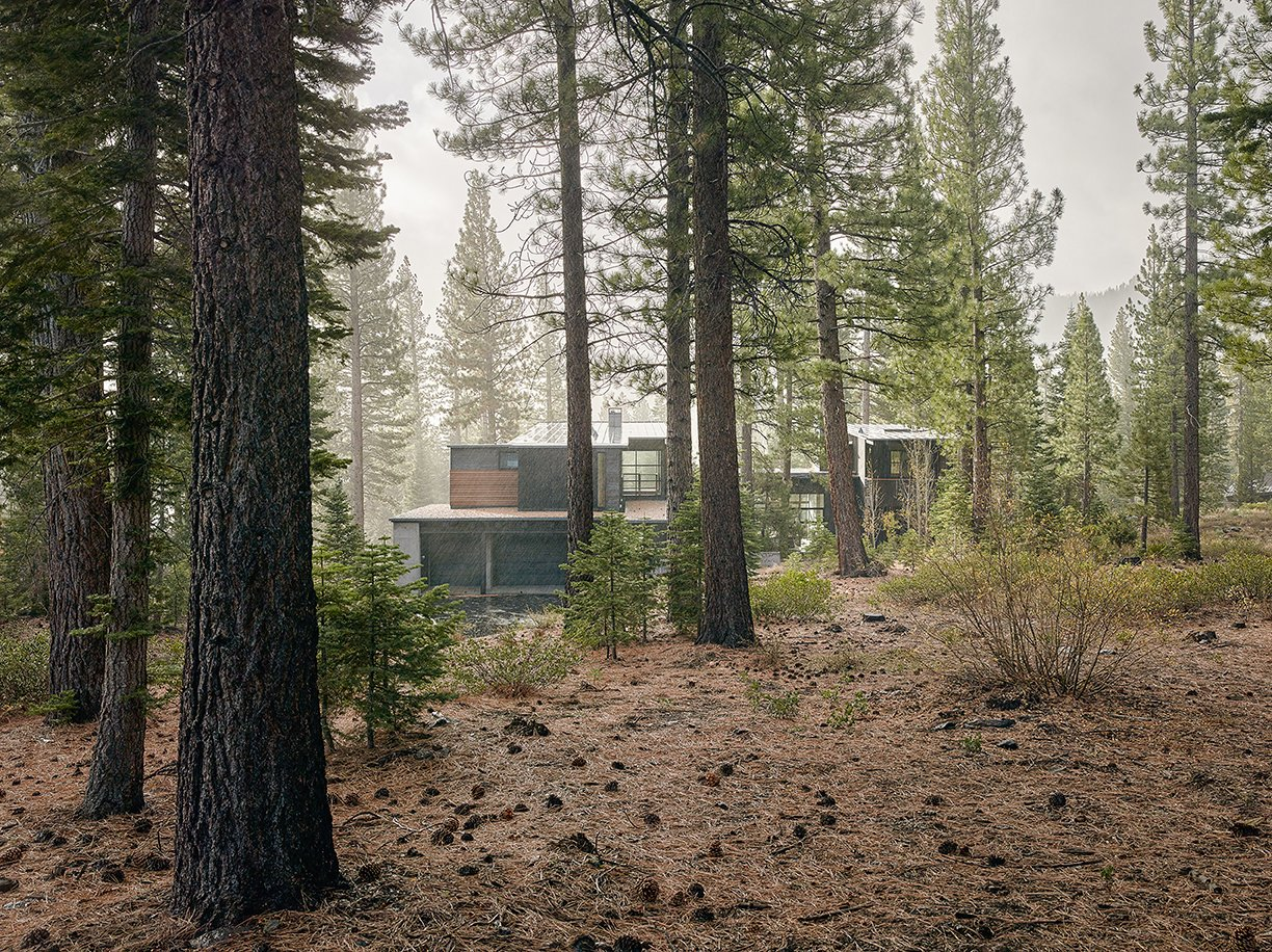 Exterior, House Building Type, and Cabin Building Type The charred cedar–clad structure in Truckee, California, was designed by architect Greg Faulkner, for a family with grown children that wanted a place to host friends.  Photo 2 of 6 in A Family's California Ski Retreat is Designed to Blend in With Its Site