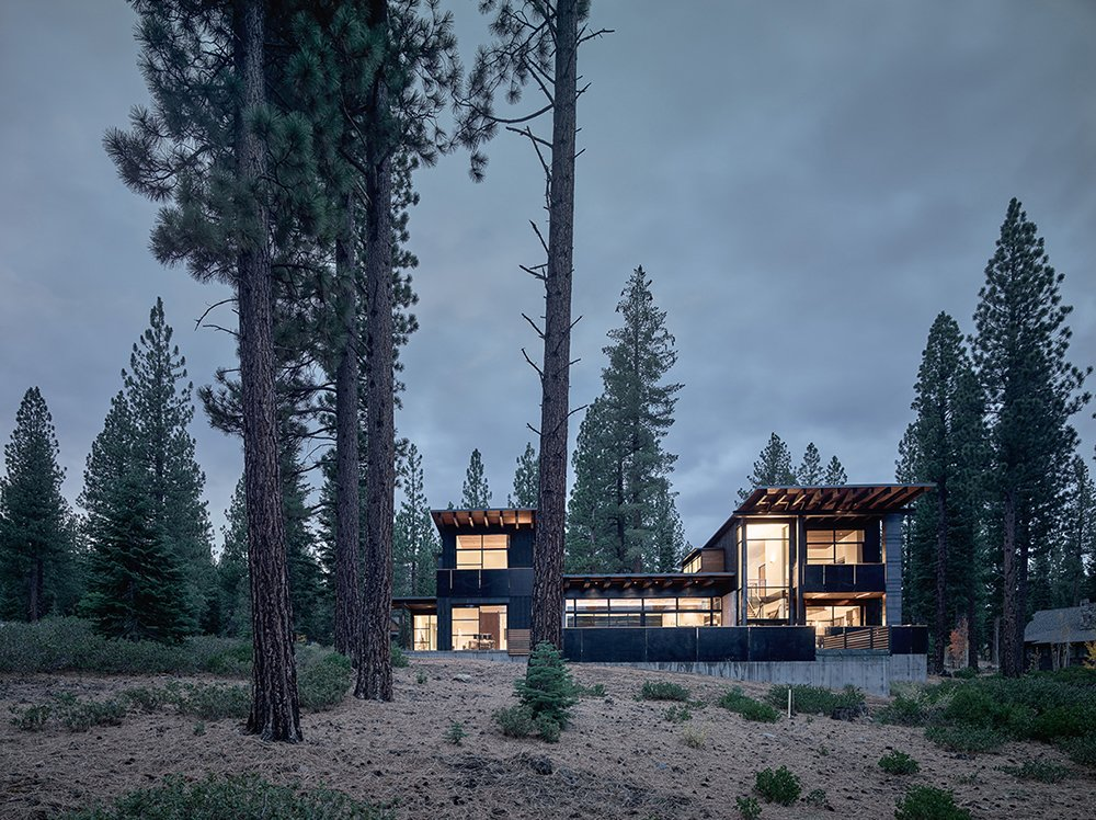 Exterior, Cabin Building Type, House Building Type, and Shed RoofLine The structure is divided into two solid vertical volumes connected by glazed living areas. The cedar cladding and steel panels reflect the hues of the surrounding forest.  Photo 6 of 6 in A Family's California Ski Retreat is Designed to Blend in With Its Site