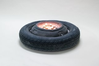 Alexander Heffesse's Construction Site scented candle recalls the warm glow of roadside fires. Light the wicks in this tire-shaped piece and be transported to the vacant lot of your dreams.