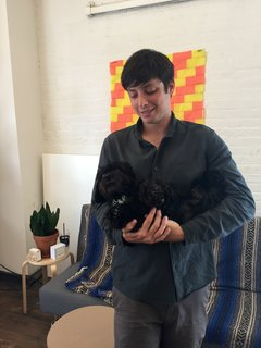 Good Thing founder Jamie Wolfond holds office mascot Arthur in the Brooklyn office of his manufacturing brand, Good Thing.