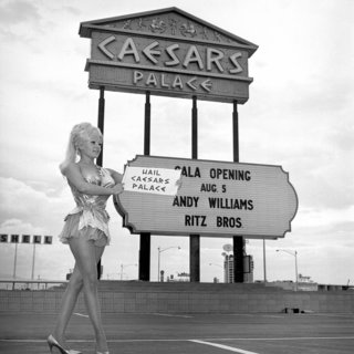 A Caesars Palace employee poses by the themed marquee, created by Ad-Art based on a design by the famous Young Electric Sign Design Company, prior to the hotel's grand opening.