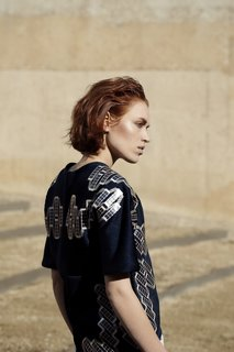 Pauline Van Dongen's Solar Shirt uses 120 thin-film solar cells integrated directly into the fabric to generate up to 1 watt of electricity to keep devices charged.