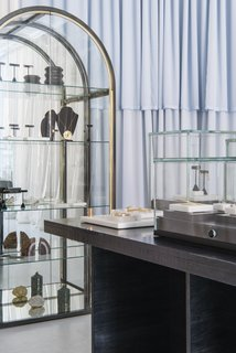 A vintage 1970s mirrored case by the Design Institute of America displays select treasures on the back wall of the shop.