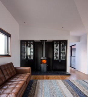A Morsø space heater warms the living room, which features a rug from Halcyon Lake.
