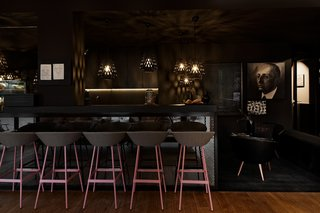 The bar at Libertine Lindenberg features a dark and moody color palette.