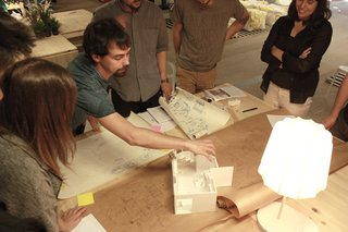 The ENORME Studio team works with a model to develop the Home Back Home #03 prototype project.