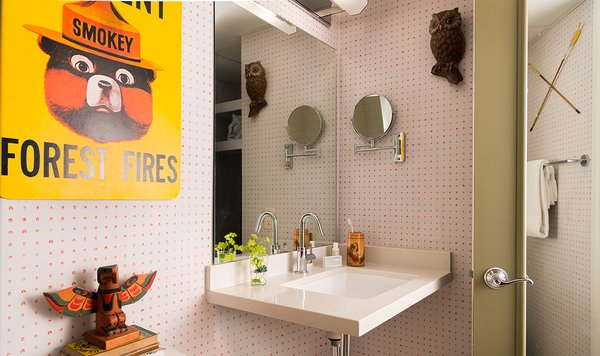 Kitschy references to camp culture, like this warning from Smokey the Bear, can be found throughout the space, but its amenities are all grown up, including Malin + Goetz toiletries.