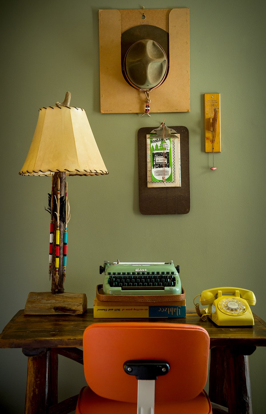 Office, Chair, Desk, and Lamps The carefully organized workstation is a nod to scoutmaster rooms, complete with a traditional office chair and antique Adirondack desk.  Photo 5 of 10 in This Wisconsin Hotel Suite Conjures the Best of Summer Camp—Hold the Bug Spray