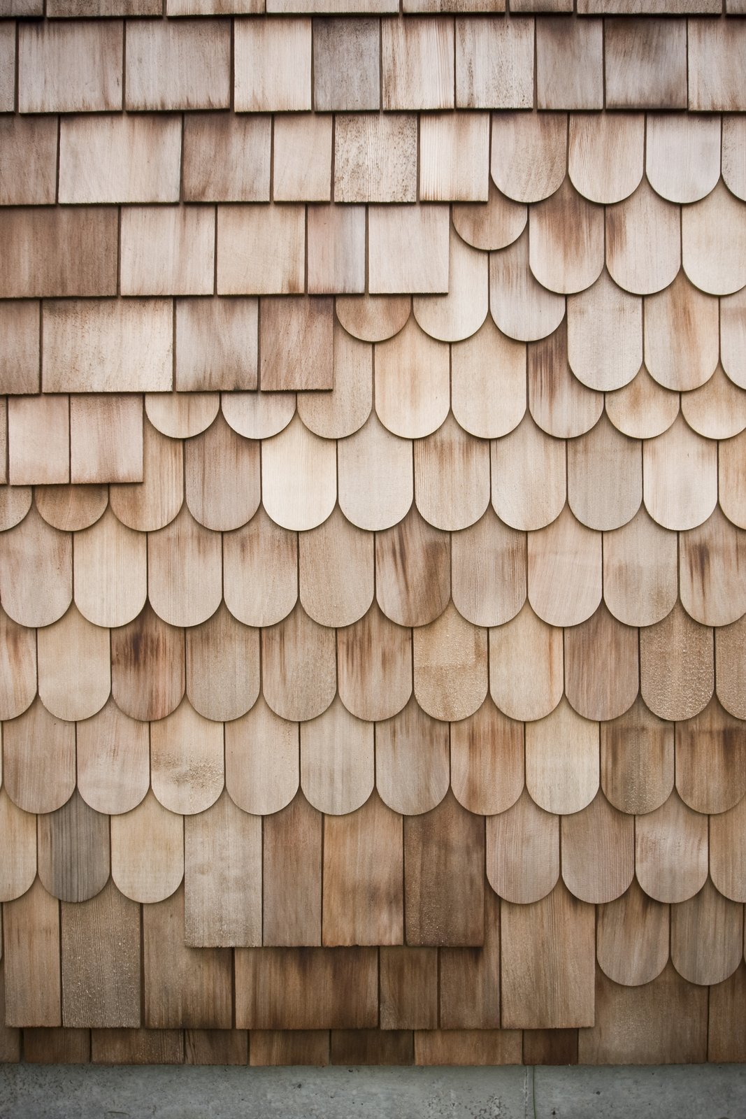 A mix of red cedar shingles and scales make of the exterior. The design is intended to be a  Photo 3 of 7 in This Minimal Japanese Getaway Was Built for Surfing
