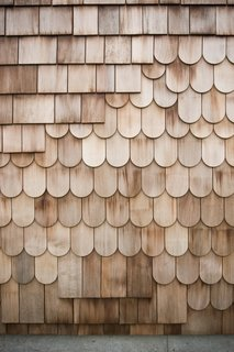 "Boards, Battens, and Bevels: Wood Board Siding Types and Their Uses - Photo 8 of 9 - ""Fancy cut"" shingles are less common but equally effective in protecting interiors from the elements."