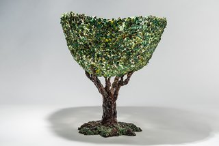 "Breaking the Mold: A Conversation With Architect, Artist, and Iconoclast Gaetano Pesce - Photo 5 of 6 - The tree vase is the result of a mosaic or decoupage technique in which pieces of resin were collaged on the surface to mimic foliage. ""When you have new possibilities your ideas become more at reach,"" Pesce says."