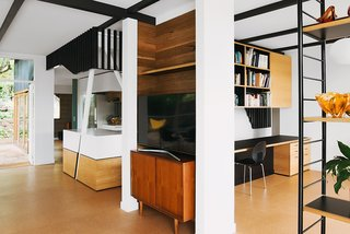 Two angled columns emerge from the kitchen, one of many ways Nest used geometry to divide the space without obstructing sight lines. The architects intentionally opted for oblique angles that would provide a variety of different views.