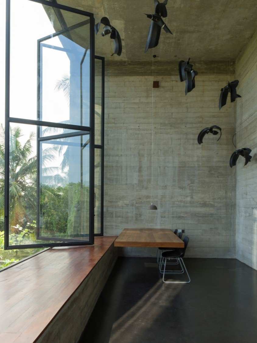 Study Room Type, Chair, Desk, Windows, and Metal Among the most dramatic spaces is the double-height office with sculptural installation.  Photo 7 of 7 in An Architect's Home and Studio Rises Above Rajagiriya
