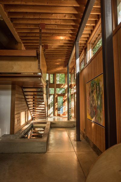 The new spaces recall the original design with their use of natural materials like wood and stone.