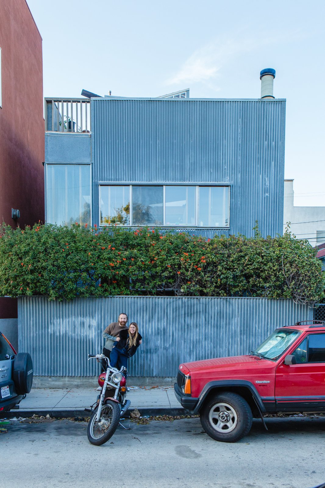 William Fowler and Kristin Grant Fowler of Dust to Dust Furniture outside their home in Frank Gehry's 1980 corrugated-iron Spiller House in Venice Beach, California.   Photo 2 of 12 in Peek Inside the Frank Gehry Rental of an Emerging L.A. Furniture Designer