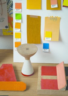 Color samples surround a model of Pinch's fisherman-inspired Float table.