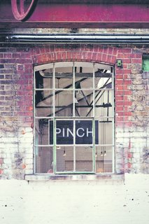 The exterior of the Pinch showroom and studio shows its industrial past.