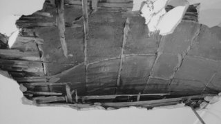 Demolition revealed the apartment's original brick ceiling.