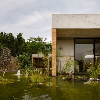Located outside of Mexico City, Casa GP by architecture firm Ambrosi | Etchegaray integrates the local landscape with features like this pond.
